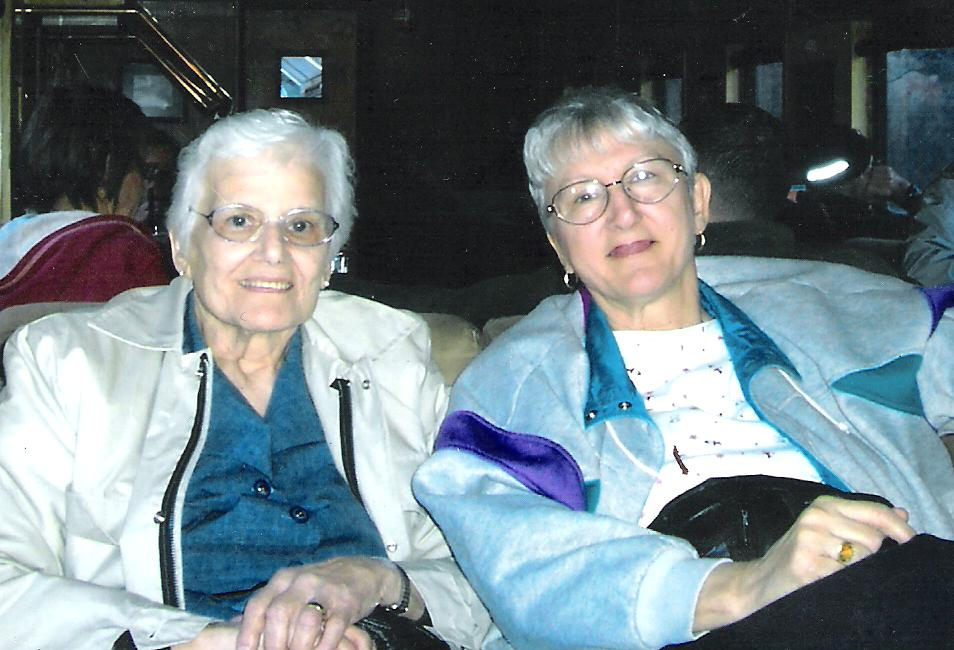 My mother's younger sister who doubles as my aunt and godmother,  pictured here with my mom.