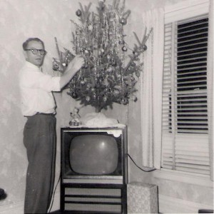 My dad in 1960.  Did he stash a box of chocolate covered cherries under the tree when mom wasn't looking??