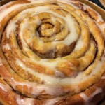 The dough shaped into a jumbo cinnamon roll!