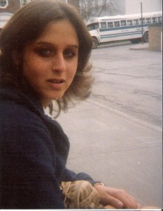 Debbie around 1979.  You can see the college bus in the background!