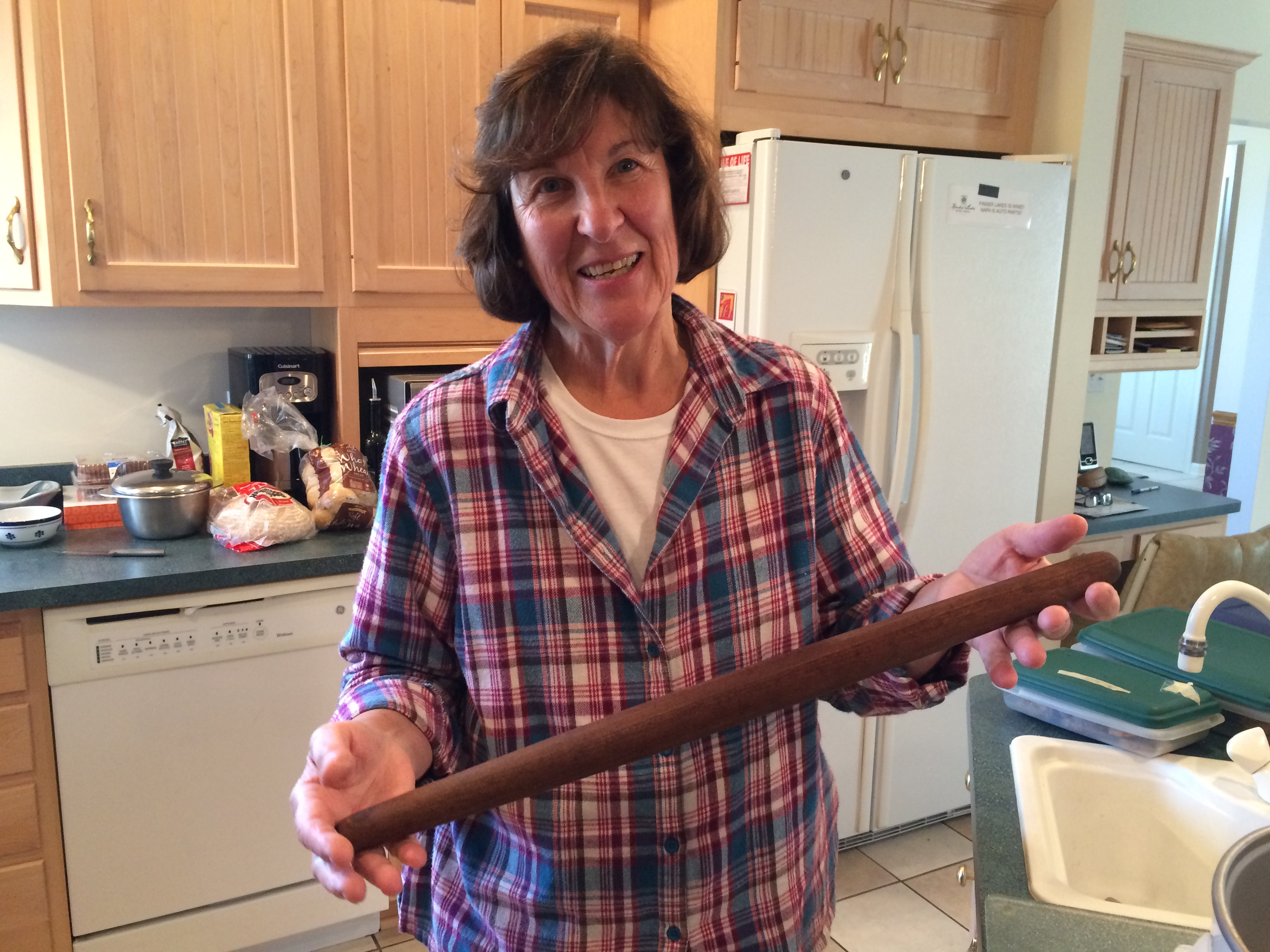 Caryn with her grandmother's rolling pin.  (Did she need that to keep her brood in order or just to roll pie crust??)