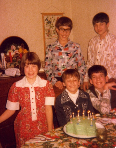 All 5 siblings pictured here at Shawn's Christmas Eve birthday celebration:  Jeanine, Shawn, and Todd are in front.  Darrell and Bruce in the back.