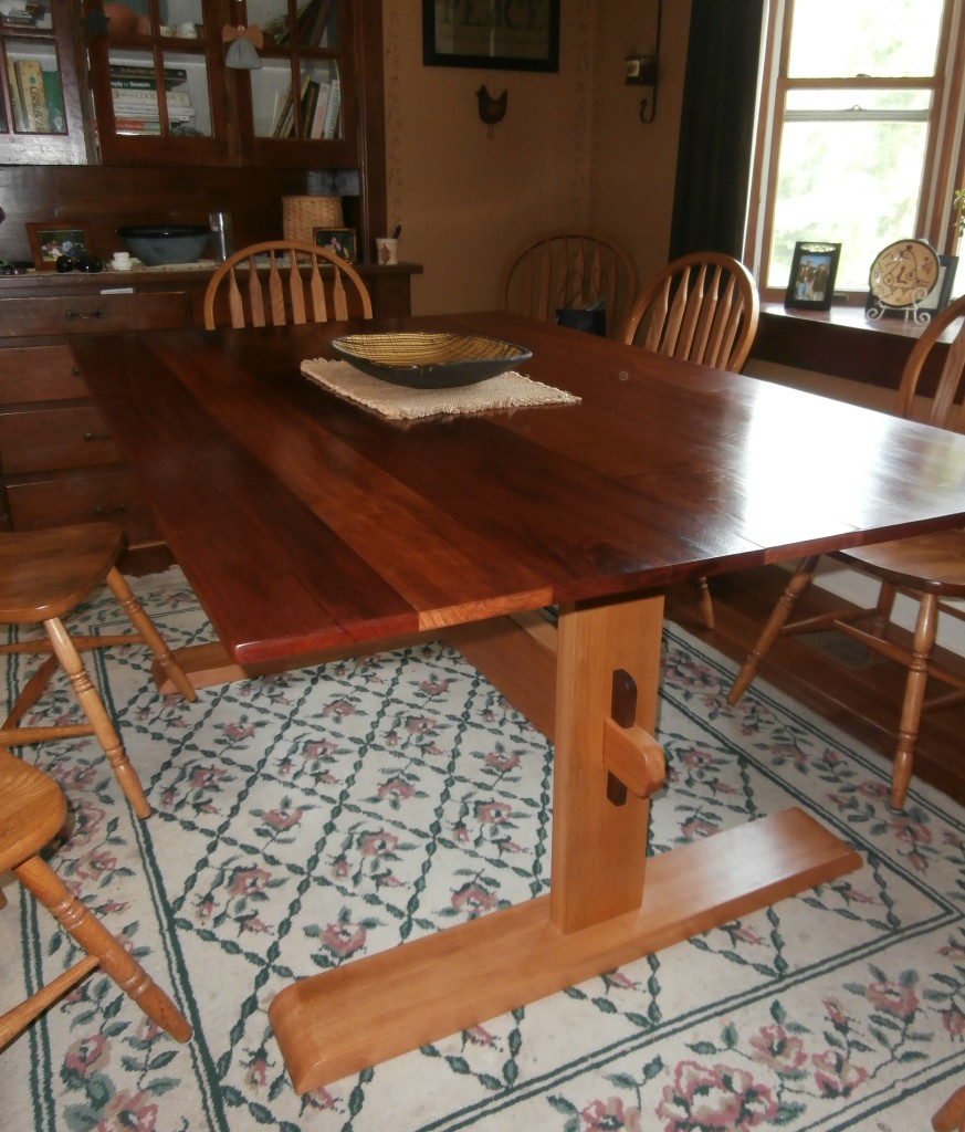 Our farm table made from reclaimed beams from our renovation!